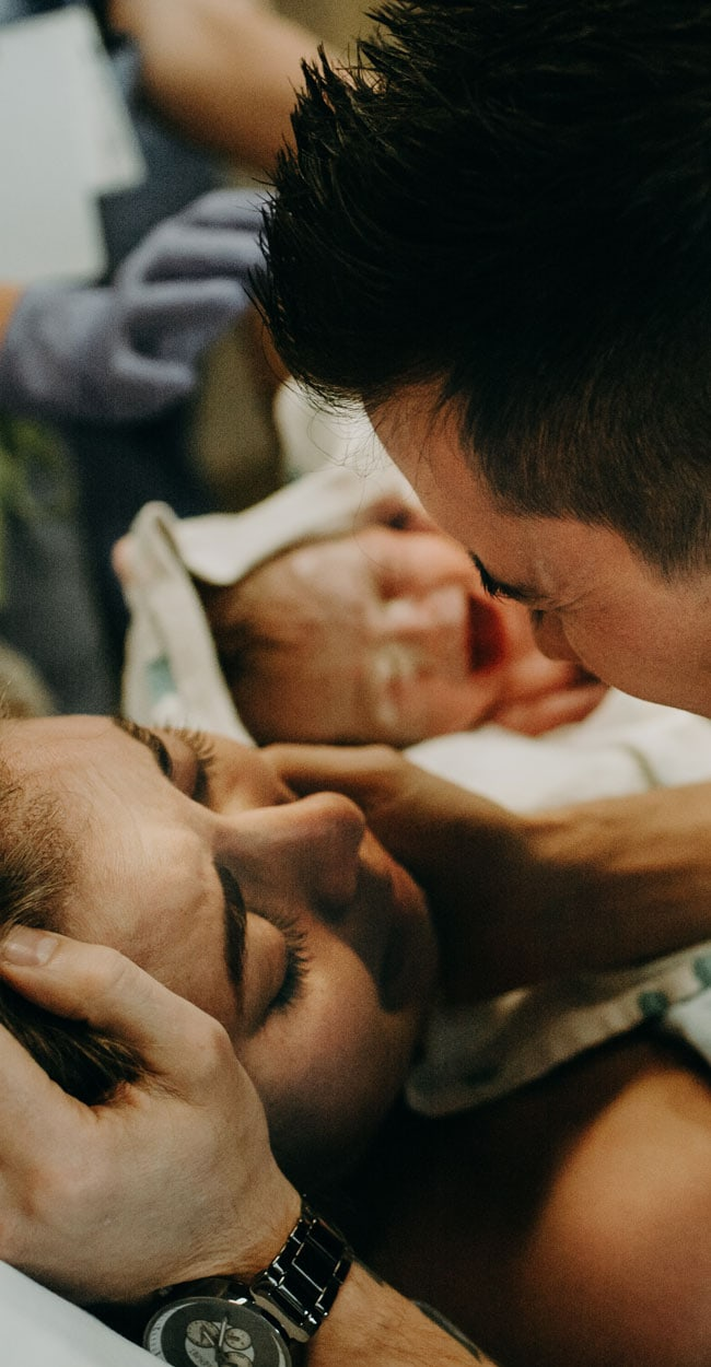 Birth Doula, husband holding his wife's face after she just gave birth
