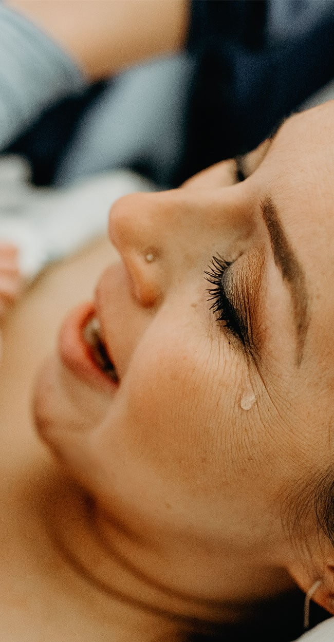 Birth Doula, close up of mother crying right after birth