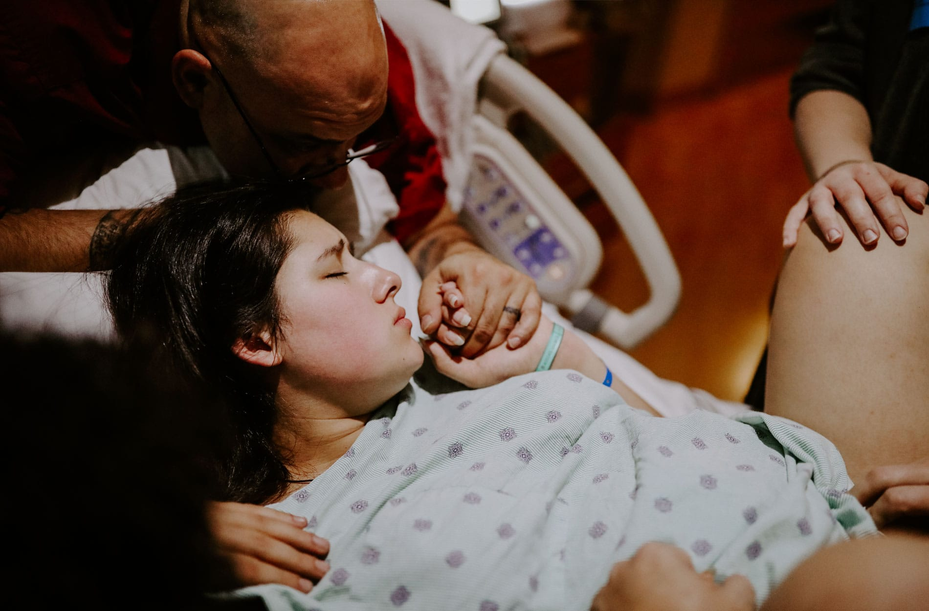 Birth Doula, man and woman holding hands during labor